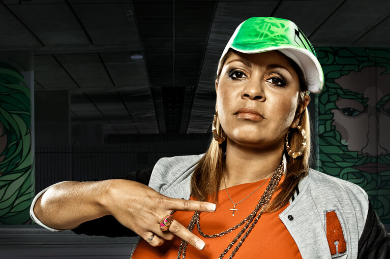 A girl with cap posing a V sign with her hand