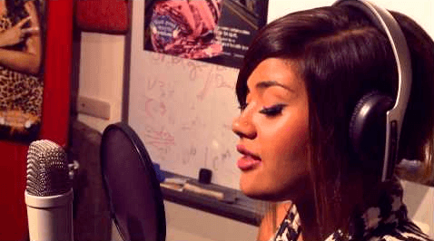 Girl giving song recording in a studio